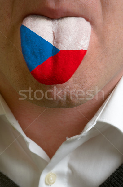 man tongue painted in czech flag symbolizing to knowledge to spe Stock photo © vepar5