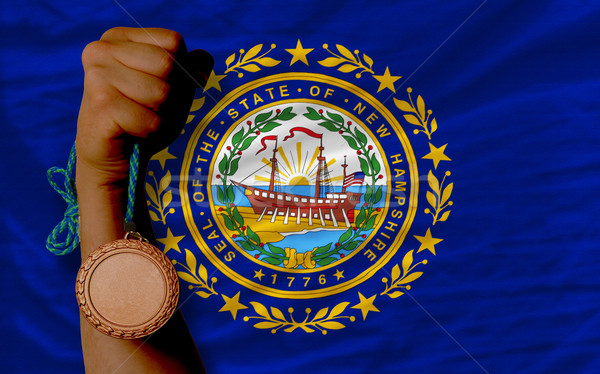 Stock photo: Bronze medal for sport and  flag of american state of new hampsh
