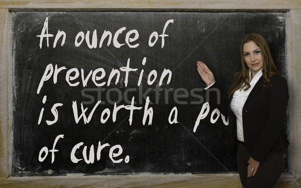 Teacher showing An ounce of prevention is worth a pound of cure2 Stock photo © vepar5