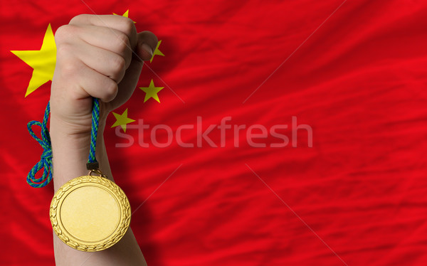 Gold medal for sport and  national flag of china    Stock photo © vepar5