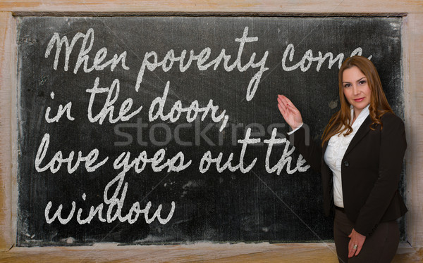 Teacher showing When poverty come in the door, love goes out the Stock photo © vepar5