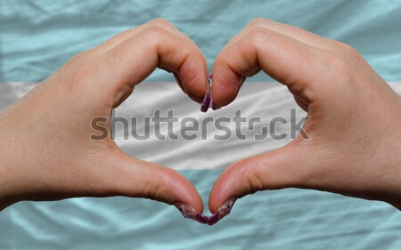 over flag of djibuti showed heart and love gesture made by hands Stock photo © vepar5