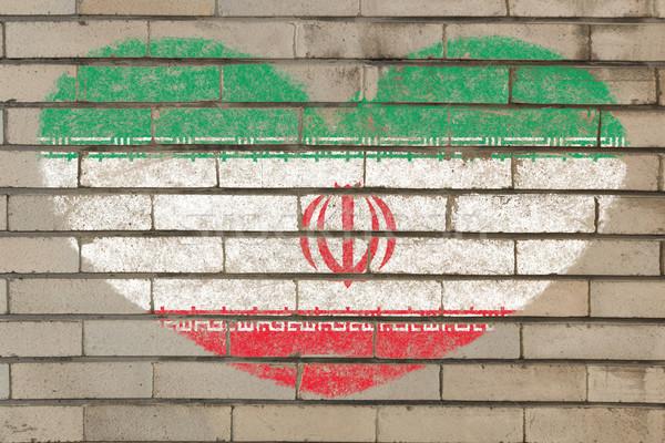 Stock photo: heart shape flag of iran on brick wall