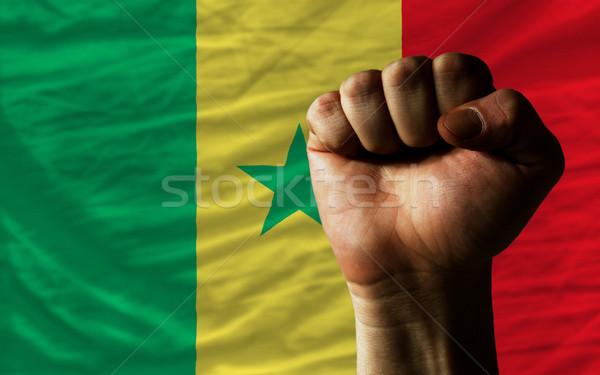 Hard fist in front of senegal flag symbolizing power Stock photo © vepar5