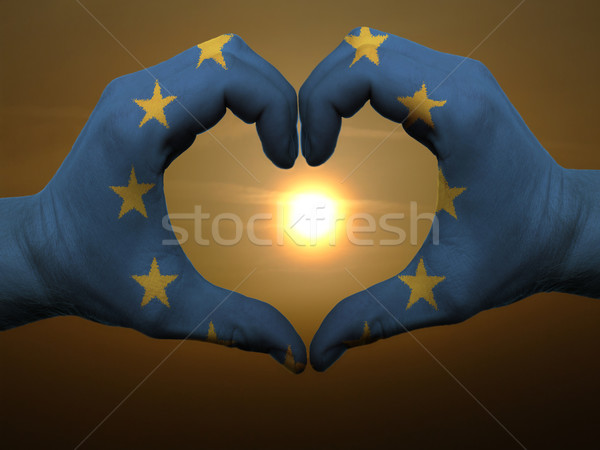 Heart and love gesture by hands colored in eu flag during beauti Stock photo © vepar5