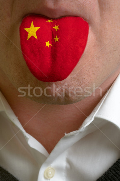 man tongue painted in china flag symbolizing to knowledge to spe Stock photo © vepar5