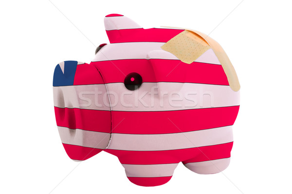 closed piggy rich bank with bandage in colors national flag of l Stock photo © vepar5