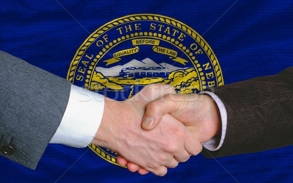 Amerikai zászló Nebraska kettő üzletemberek kéz Stock fotó © vepar5