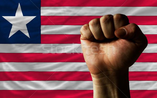 Hard fist in front of liberia flag symbolizing power Stock photo © vepar5
