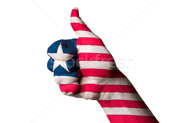 liberia national flag thumb up gesture for excellence and achiev Stock photo © vepar5