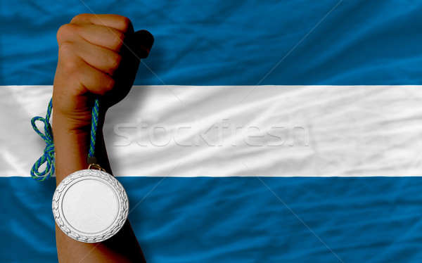 Silver medal for sport and  national flag of el salvador    Stock photo © vepar5