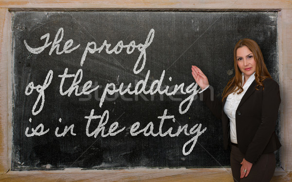 Teacher showing The proof of the pudding is in the eating on bla Stock photo © vepar5