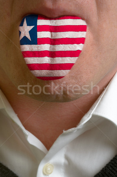 man tongue painted in liberia flag symbolizing to knowledge to s Stock photo © vepar5