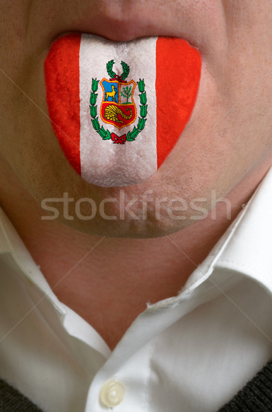 man tongue painted in peru flag symbolizing to knowledge to spea Stock photo © vepar5