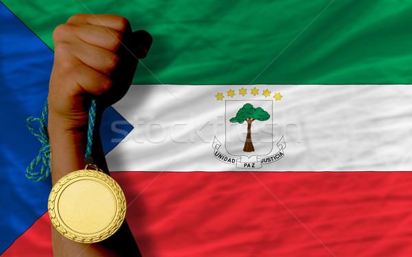 Aranyérem sport zászló Egyenlítői-Guinea nyertes tart Stock fotó © vepar5