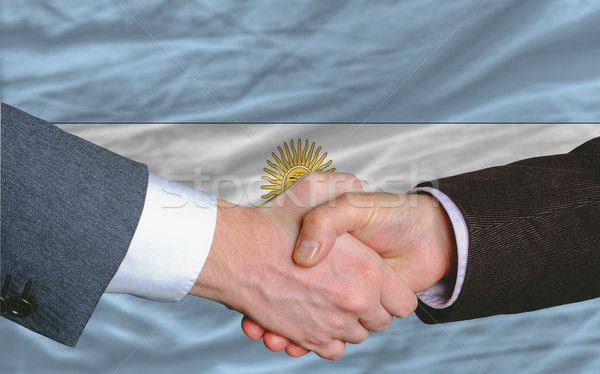 businessmen handshake after good deal in front of argentina flag Stock photo © vepar5