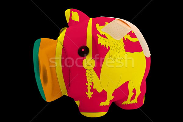 bankrupt piggy rich bank in colors of national flag of srilanka  Stock photo © vepar5