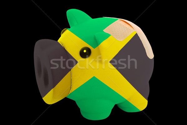 bankrupt piggy rich bank in colors of national flag of jamaica   Stock photo © vepar5