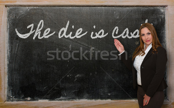 Teacher showing The die is cast on blackboard Stock photo © vepar5
