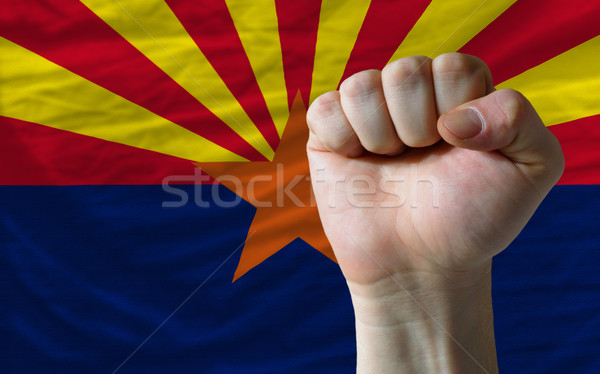 us state flag of arizona with hard fist in front of it symbolizi Stock photo © vepar5
