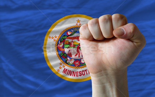 us state flag of minnesota with hard fist in front of it symboli Stock photo © vepar5