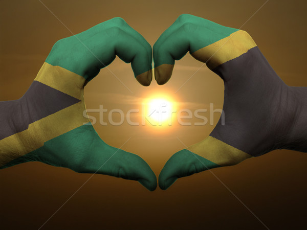 Heart and love gesture by hands colored in jamaica flag during b Stock photo © vepar5