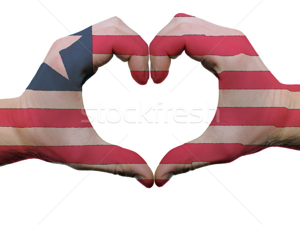 Heart and love gesture in liberia flag colors by hands isolated  Stock photo © vepar5
