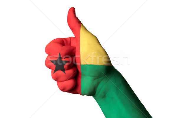 guinea bissau national flag thumb up gesture for excellence and  Stock photo © vepar5
