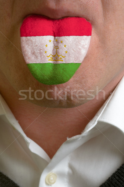 man tongue painted in tajikistan flag symbolizing to knowledge t Stock photo © vepar5