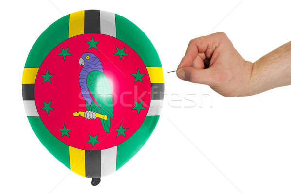 Bursting balloon colored in  national flag of dominica    Stock photo © vepar5