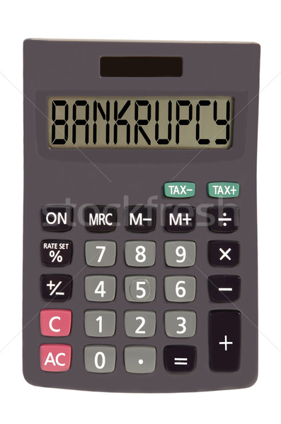 Old calculator on white background showing text 'bankrupcy' Stock photo © vepar5