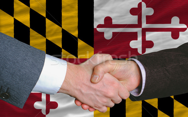 in front of american state flag of maryland two businessmen hand Stock photo © vepar5