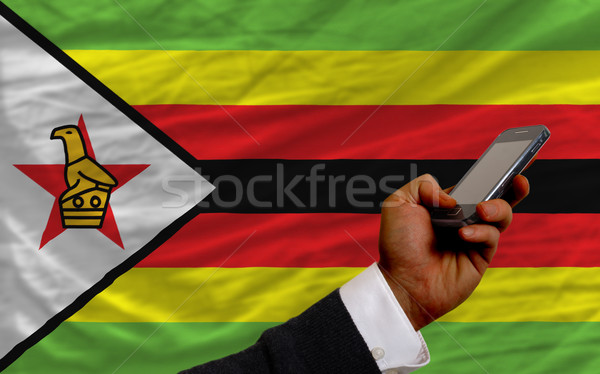 cell phone in front  national flag of zimbabwe    Stock photo © vepar5