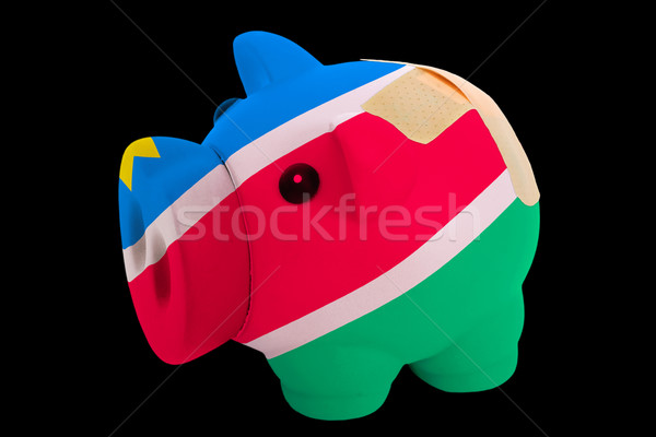 bankrupt piggy rich bank in colors of national flag of namibia   Stock photo © vepar5