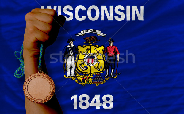 Bronze medal for sport and  flag of american state of wisconsin  Stock photo © vepar5