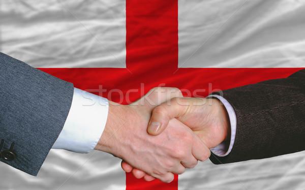 Stock photo: businessmen handshake after good deal in front of england flag