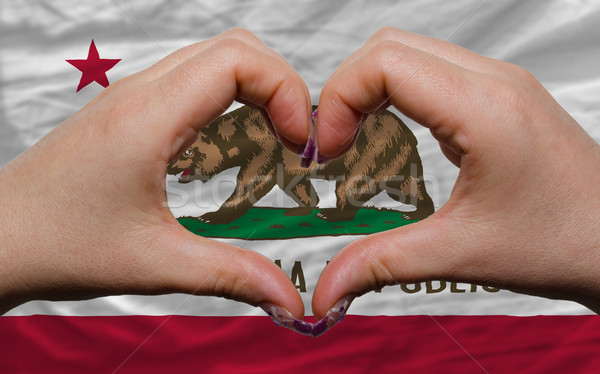 over american state flag of california showed heart and love ges Stock photo © vepar5