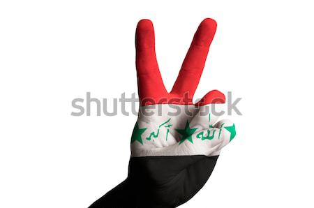 california us state flag two finger up gesture for victory and w Stock photo © vepar5