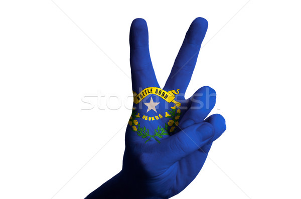 nevada us state flag two finger up gesture for victory and winne Stock photo © vepar5