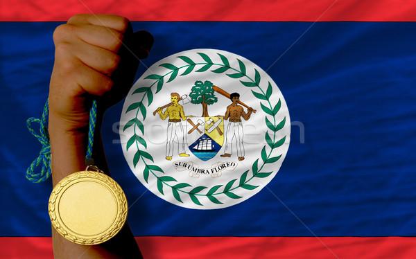 Aranyérem sport zászló Belize nyertes tart Stock fotó © vepar5