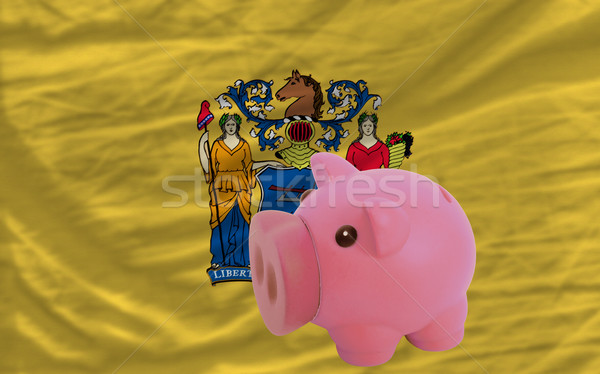 piggy rich bank and  flag of american state of new jersey    Stock photo © vepar5
