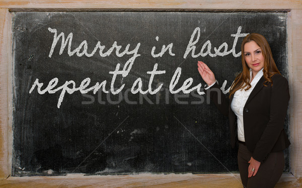 Teacher showing Marry in haste, repent at leisure on blackboard Stock photo © vepar5