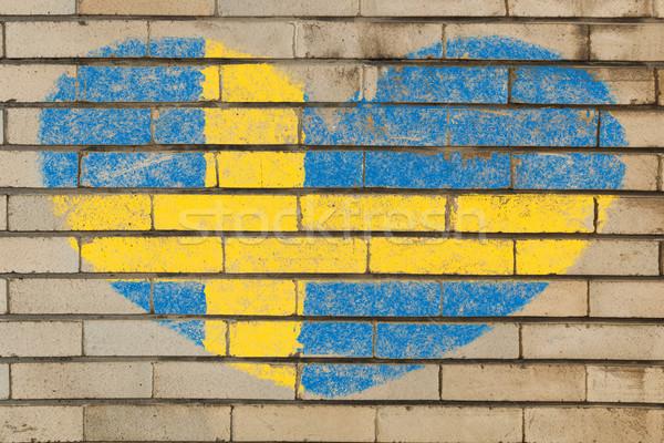 Kalp şekli bayrak İsveç tuğla duvar kalp Stok fotoğraf © vepar5