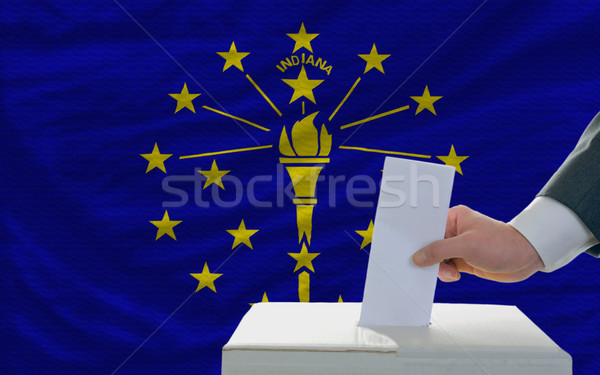 man voting on elections in front of flag US state flag of indian Stock photo © vepar5