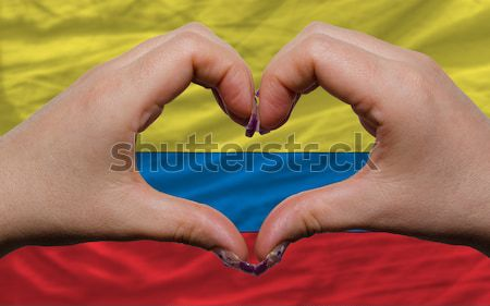 Heart and love gesture showed by hands over flag of sweden backg Stock photo © vepar5