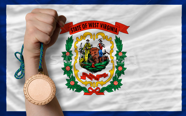 Bronze medal for sport and  flag of american state of west virgi Stock photo © vepar5