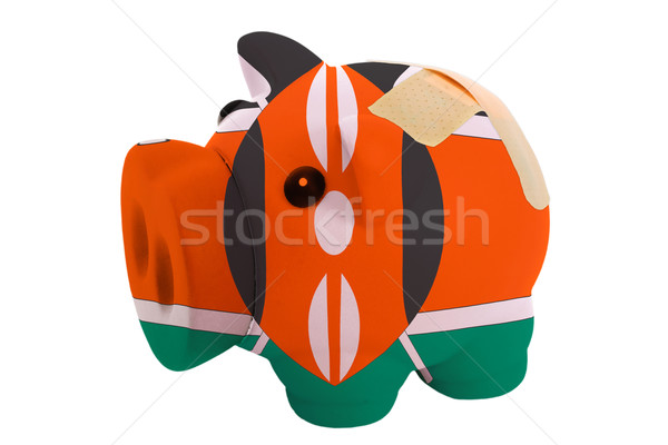 closed piggy rich bank with bandage in colors national flag of k Stock photo © vepar5
