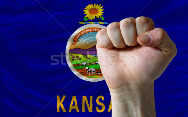 us state flag of kansas with hard fist in front of it symbolizin Stock photo © vepar5