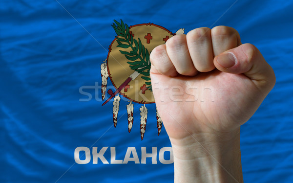 us state flag of oklahoma with hard fist in front of it symboliz Stock photo © vepar5