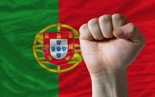 Hard fist in front of portugal flag symbolizing power Stock photo © vepar5